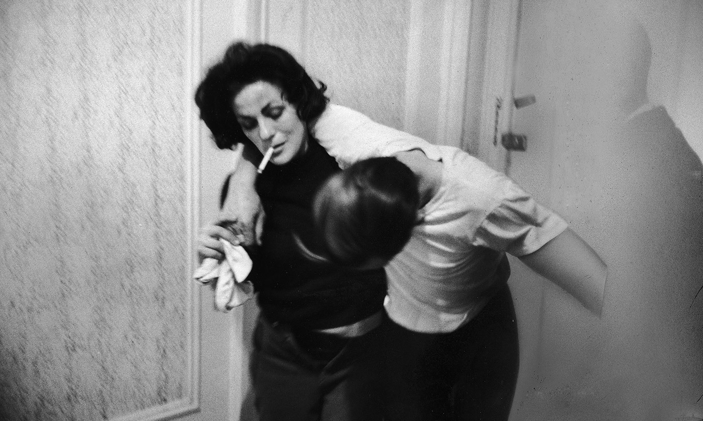 Karen, a heroin addict, trying to save a fellow addict who has overdosed, New York, October 1964. <em>Photo by Bill Eppridge/The LIFE Picture Collection</em>