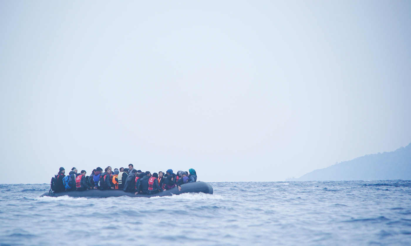 <p>A refugee boat off the coast of Lesbos, Greece. <em>Courtesy Wikipedia</em></p>