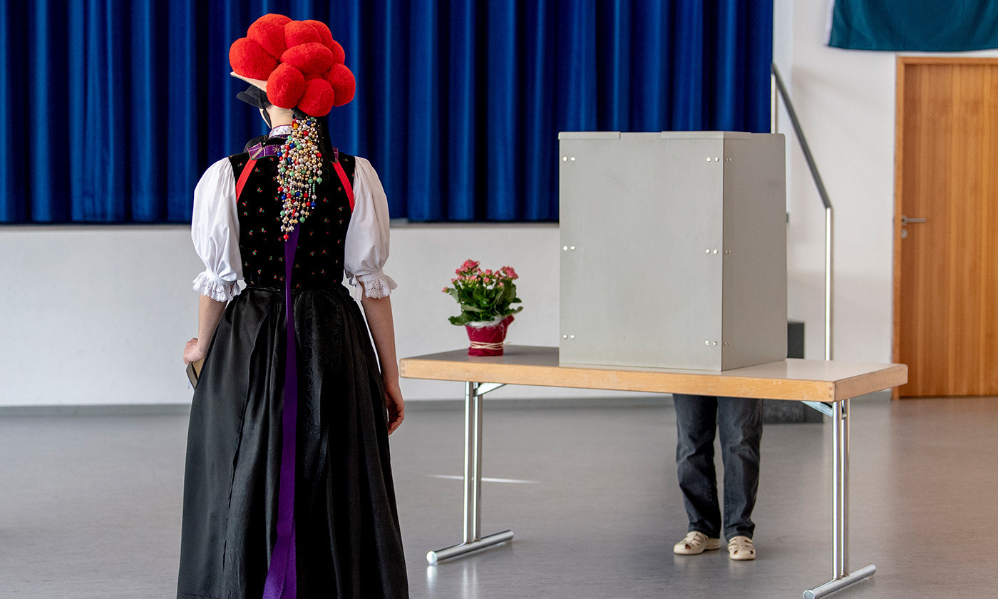 <p>A voter in traditional Black Forest costume at the polling station during the European elections. Baden-Württemberg, Germany, May 2019. <em>Photo by Patrick Seeger/Dpa/Getty</em></p>