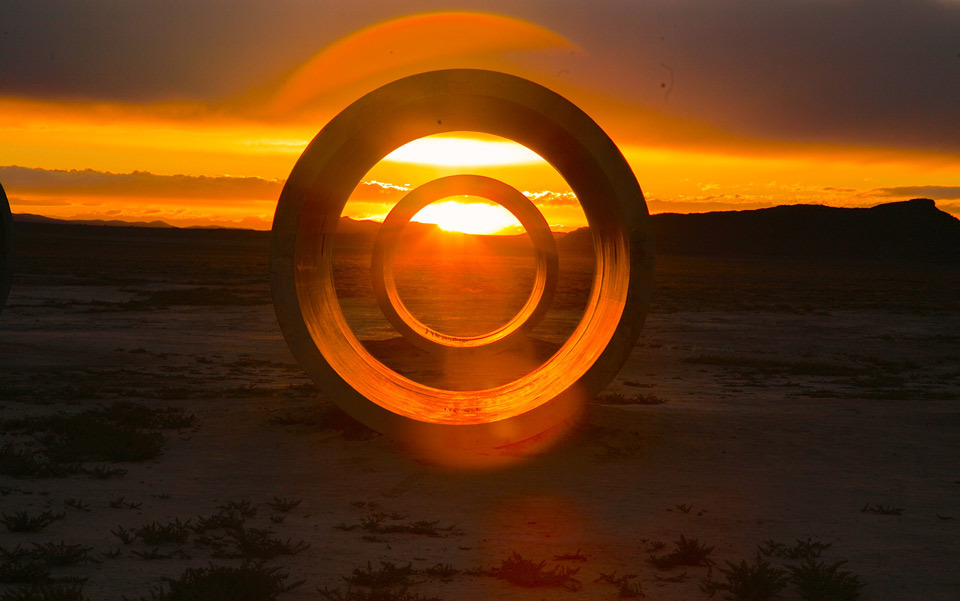 Nancy Holt's Sun Tunnels at sunset on the summer solstice. Photo by Nick Paloukos